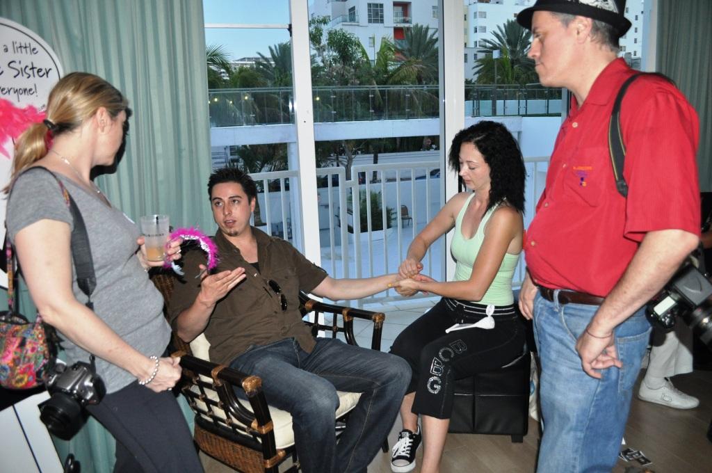 Visitors to the Wine Sisterhood Sassy Suite Enjoy Hand Massages