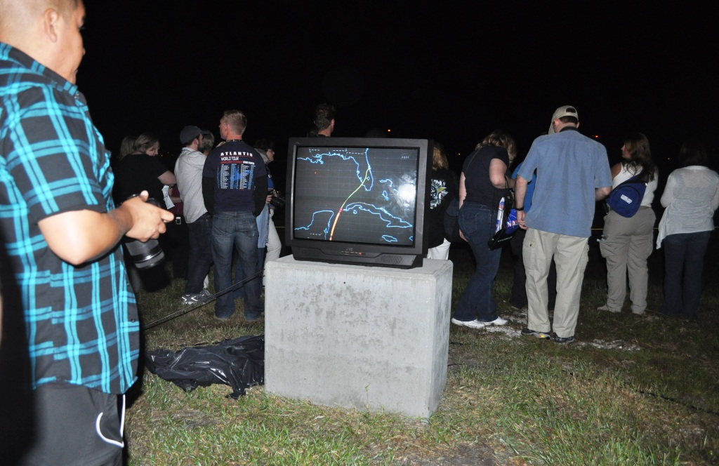 Crowd and Monitor at the Space Shuttle Landing Facility, Kennedy Space Center, Fla.