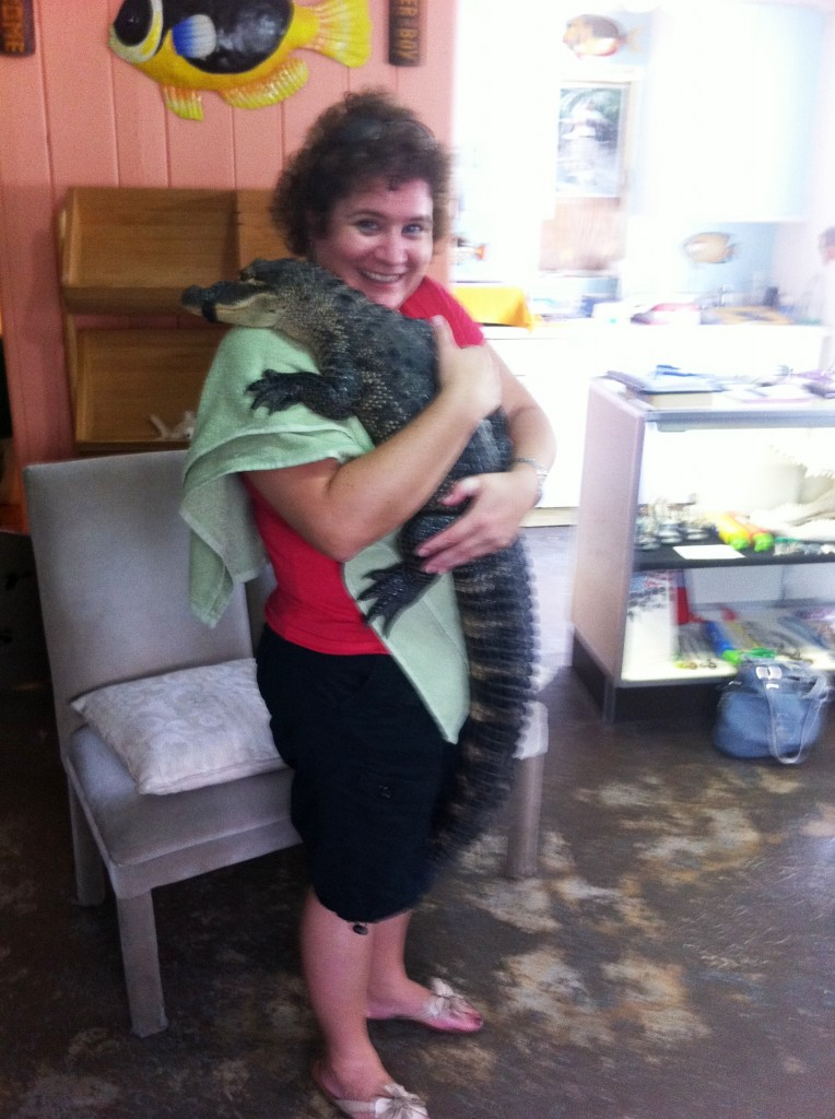 Hugging an Alligator, Just Like a Baby, Naples, Fla.