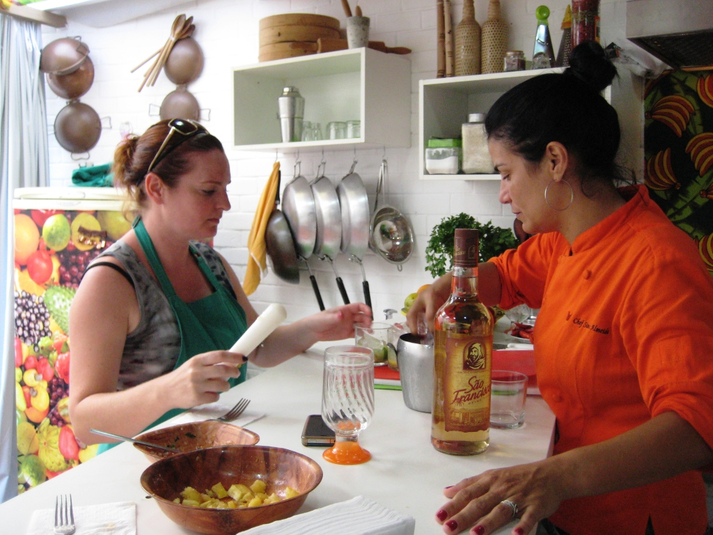 Lizzy Learning How to Make Caprihans with Chef Simone During Cook in Rio
