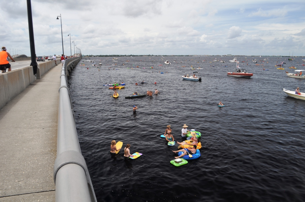 22nd Annual Freedom Swim Participants Cross the Peace River with Foam Noodles, Inflatable Rafts and Patriotic Colors, Charlotte Harbor, Fla., July 4, 2013