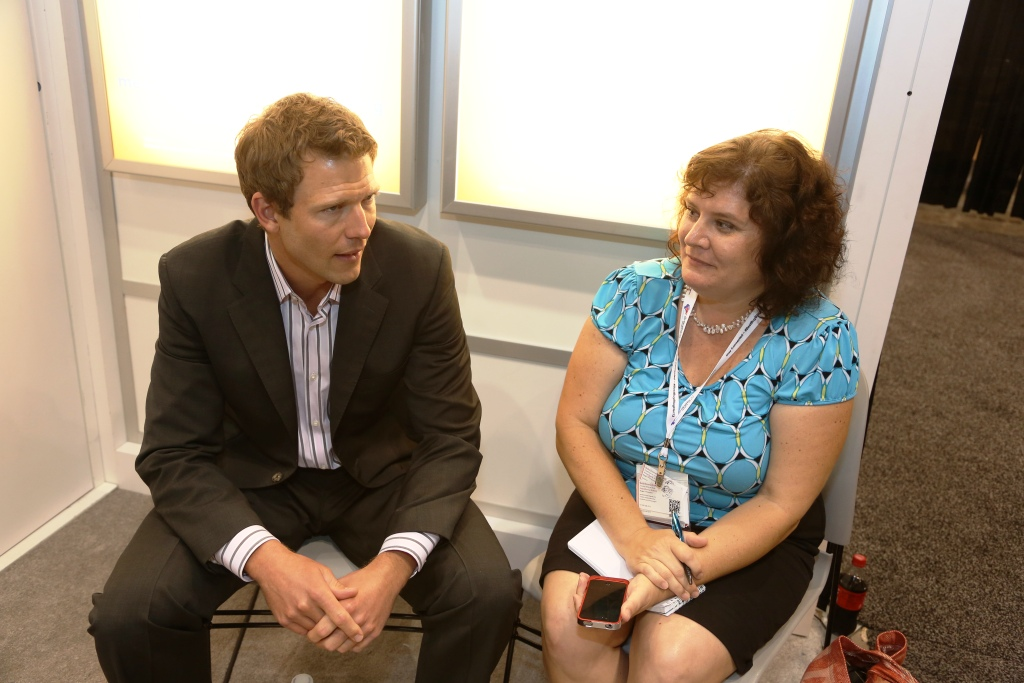 Learning How I Can Stay Healthier when Traveling from Dr. Travis Stork for Simply Saline Nasal Spray Booth At BlogHer Conference In Chicago, July 2013