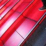 Walking the Ruby-Red Stairs Above the Times Square TKTS Booth