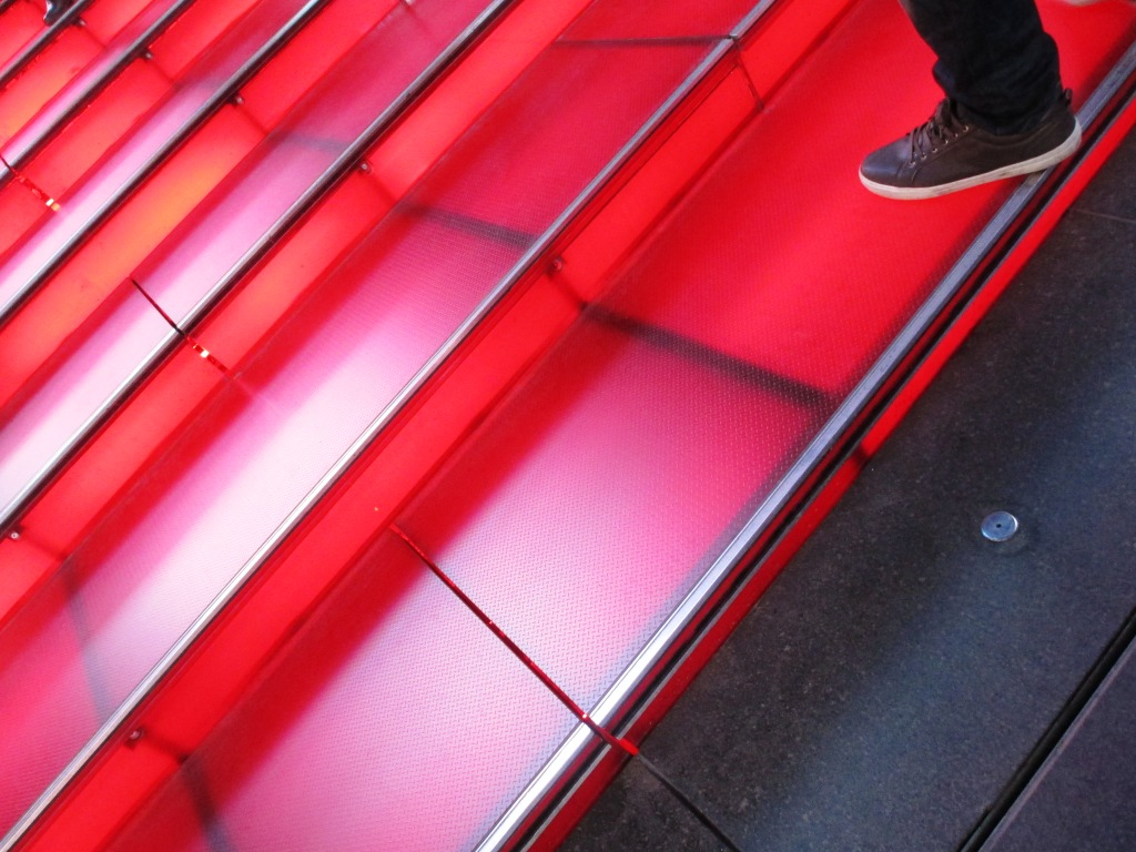 Come Take a Walk with Me Up the Ruby-Red Stairs Above the TKTS Booth in Times Square, New York, N.Y.